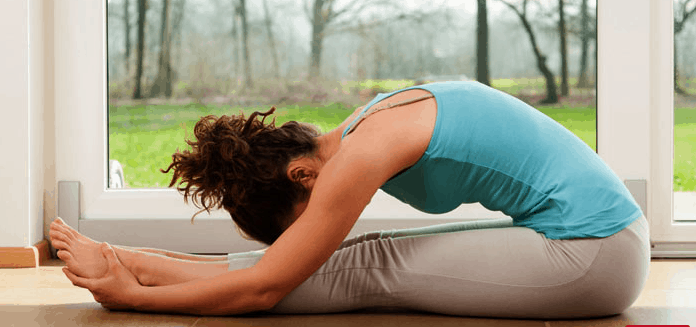 paschimottanasana or back pain yoga pose for quick relief